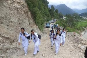 Board students rush to the examination centre walking on a hilly terrain in Uttarkashi. The state board examinations concluded on March 24 and results are awaited on May 26.