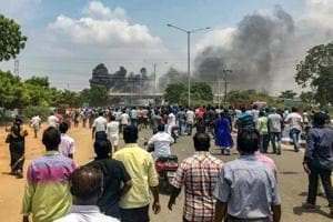 Smoke billows out of burning vehicles after a violent protest demanding closure of Vedanta