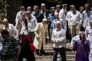 Local Muslims leave a Mosque after Friday prayers at Hotan in China