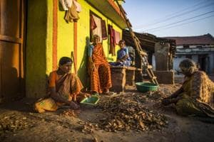 Women sort nuts outside their home in the village of Kuragunda in Karnataka. With almost 70 percent of India