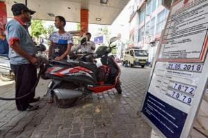 A view of a fuel station displaying the current fuel prices, in Guwahati, on Monday.