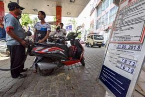 A fuel station displaying the current fuel prices in Guwahati on Monday. Petrol and diesel prices were increased in the range of 33-34 paise per litre and 25-27 paise per litre across Delhi, Kolkata, Mumbai and Chennai.