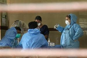 Hospital staff wears safety masks as a precautionary measure at the Kozhikode Medical College after the