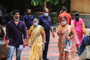Hospital staff and family members of the patients admitted at the Kozhikode Medical College wear safety masks as a precautionary measure after the Nipah virus outbreak.