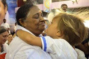 """Known among her followers as """"Amma,"""" which means """"mother"""" in several Indian languages, Amritanandamayi has devotees in India and the rest of the world. She is also popularly known as the Hugging Saint."""