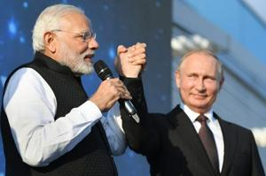 Strengthening bilateral ties through the energy sector figured prominently in talks Prime Minister Narendra Modi held with Russian President Vladimir Putin on Monday at an informal summit in the Black Sea resort of Sochi.