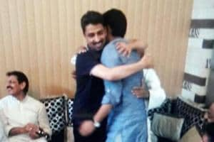 Imran Masood and Nahid Hasan embracing each other.