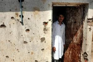 A villager inspects the damage after his home was gutted by Pakistan firing in Jora village in RS Pura district of Jammu on Tuesday.