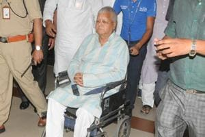 RJD chief Lalu Prasad being escorted on a wheelchair, in Patna.