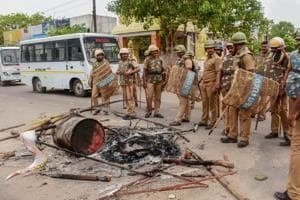 Police personnel deployed after violent protests demanding the closure of Vedanta
