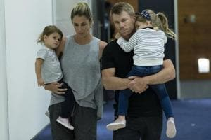 David Warner and his wife Candice arrive at Sydney International Airport with their children on March 29, 2018 in Sydney after the ball tampering row in South Africa.