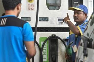 A petrol pump employee serves a customer at a fuel station, as fuel prices reached the highest-ever, in Mumbai on Thursday.