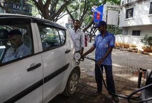 An attendant refuels a vehicle at a Hindustan Petroleum Corp. gas station in Bengaluru, India.