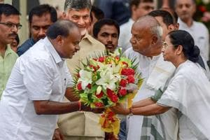 Newly Sworn-in Karnataka Chief Minister H D Kumaraswamy being presented a bouquet by West Bengal Chief Minister Mamta Banerjee as AP CM Chandrababu Naidu looks on during the swearing-in ceremony of JD(S)-Congress coalition Karnataka government in Bengaluru, on Wednesday.