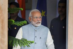 Prime Minister Narendra Modi arrives for a meeting at Hyderabad House, in New Delhi.