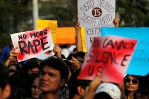 People hold placards as they participate in a protest against rapes in Mumbai.