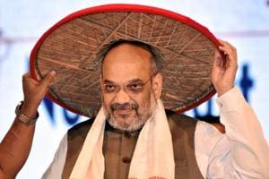 "BJP president Amit Shah at the third conclave of North East Democratic Alliance meeting in Guwahati, where he promised a ""Congress-free Northeast after the Mizoram polls""."