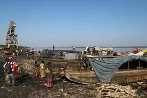 Fishing boats are seen docked on the shores of Congo River during the vaccination campaign aimed at beating an outbreak of Ebola in the port city of Mbandaka, Democratic Republic of Congo May 23, 2018.