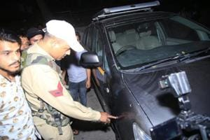 A police man checks a vehicle after suspected militants hurled grenades at a bus stand in Jammu late on Thursday late night.