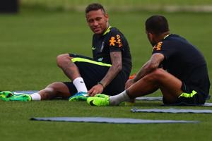 While Brazil football team star Neymar (L) has recovered from a foot fracture in time, his teammate Dani Alves will not recover from a knee injury he suffered and won't play in the 2018 FIFA World Cup in Russia.