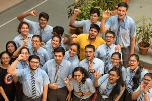 Students celebrate CBSE Class 12 results at Apeejay School, Nerul in Navi Mumbai on Saturday.