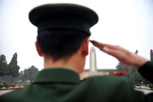 A paramilitary police officer salutes during a ceremony in China