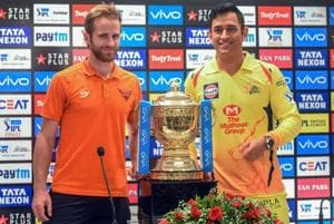 Sunrisers Hyderabad captain Kane Williamson and Chennai Super Kings captain MS Dhoni pose with IPL 2018 trophy in Mumbai on Saturday.