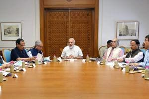 Prime Minister Narendra Modi reviews the preparations for the launch of a health scheme under Ayushman Bharat, in New Delhi.