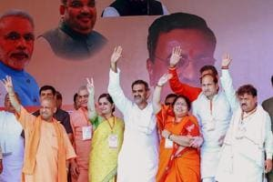 Uttar Pradesh chief minister Yogi Adityanath with BJP's Kairana candidate, Mriganka Singh, and other party leaders during a rally ahead of Kairana assembly bypolls, in Shamli on Thursday.