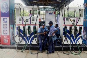Employees at a petrol Pump in Kolkata on Saturday, as the fuel prices remain at record high level.