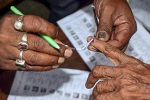 Howrah: Polling officials put an ink mark on a voter