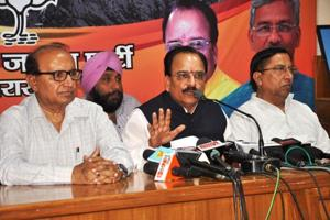 State BJP president Ajay Bhatt (C) addresses a press conference at BJP office in Dehradun on Monday.