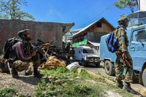 Security personnel stand guard during an encounter between security forces and militants in Pulwama district of south Kashmir.