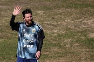 Lionel Messi of Argentina waves to fans during a training session ahead of the 2018 FIFA World Cup in Buenos Aires.