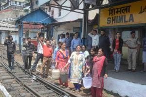 People protest water crisis at Shimla railway station on Monday.