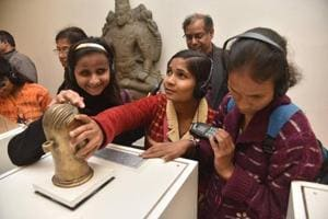 A group of visually impaired youngsters feel a tactile representation of an artwork, on display at the National Museum.