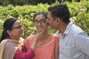 Ghaziabad's Sanya Gandhi is the joint topper in differently abled category in CBSE Class 10 exam, the results of which were declared on Tuesday. Sanya  with her parents in the picture.