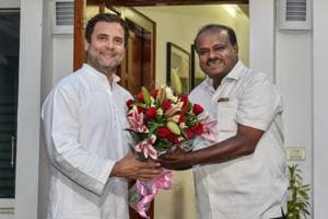 JD(S) leader and Karnataka chief minister HD Kumaraswamy presents a bouquet to Congress president Rahul Gandhi during a meeting in New Delhi.