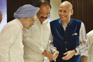 (L to R) Former Prime Minister Manmohan Singh, vice-president M Venkaiah Naidu and Congress leader Abhishek Manu Singhvi enjoy a light moment during the release of Singhvi's book 'Straight Talk', in New Delhi on Wednesday.