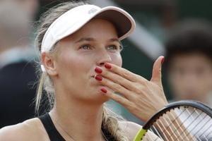 Caroline Wozniacki celebrates after defeating Spain