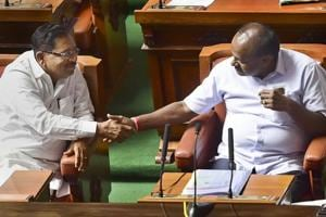 Karnataka chief minister HD Kumaraswamy and his deputy G Parameshwara greet each other after their coalition government won the trust vote by voice vote, at Vidhana Soudha in Bengaluru, on Friday.