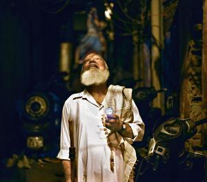 Peer Ji walking in the lanes of Old Delhi on a Ramzan night.