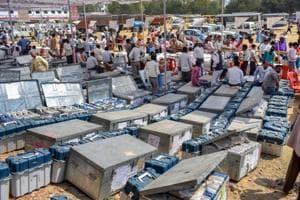Polling and presiding officers collect Electronic Voting Machines and Voter Verifiable Paper Audit Trail machines on the eve of polling for Phulpur Lok Sabha seat, in Allahabad, on Saturday.