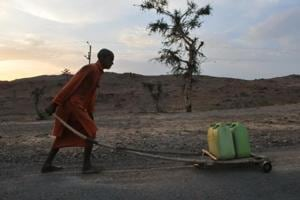 A file photo of a priest carrying water for a temple in Bundelkhand area near Prithvipur in Madhya Pradesh. Several regions of Madhya Pradesh, including Bundelkhand, has been facing acute water shortage because of scanty rainfall in last monsoon and an almost dry winter