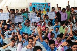 Students from SC/ST communities stage a dharna for their pending demands in Bhopal.