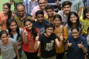 Students celebrate their success after HSC Class 12 results were declared on Wednesday.