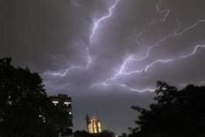 Lightning strikes over residential apartments during a thunderstorm on the outskirts of  New Delhi on May 2, 2018.