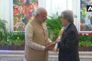 Prime Minister Narendra Modi hands over the Padma Shri award to Singapore's Tommy Koh, who is among the 10 ASEAN recipients of the award.