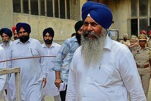 SAD's Naib Singh Kohar walking out of the counting centre before the results were declared in Shahkot on Thursday.