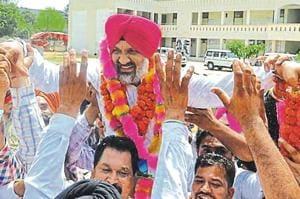 Winner Hardev Singh Ladi Sherowalia celebrating with supporters in Shahkot on Thursday.